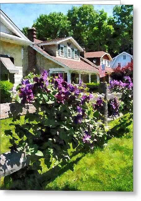 Purple Clematis On Rustic Fence Greeting Card by Susan Savad