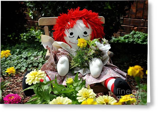 Raggedy Ann's Garden Greeting Card by Nava Thompson