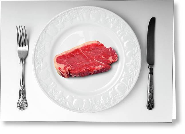 Raw Meat On White Plate Greeting Card by Victor De Schwanberg