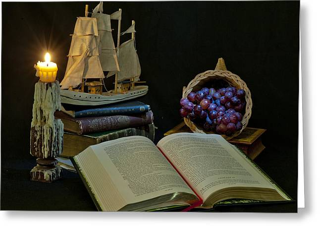 Greeting Card featuring the photograph Reading By Candlelight by Rick Hartigan