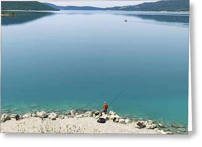 Rear View Of A Person Fishing Greeting Card by Panoramic Images