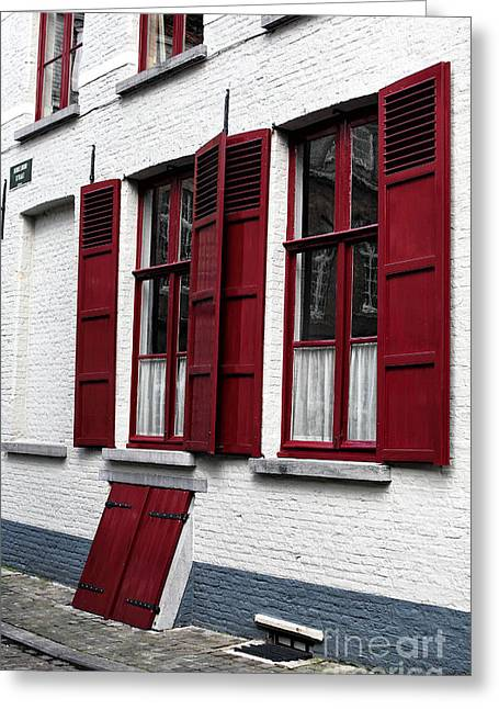 Red And White In Bruges Greeting Card by John Rizzuto