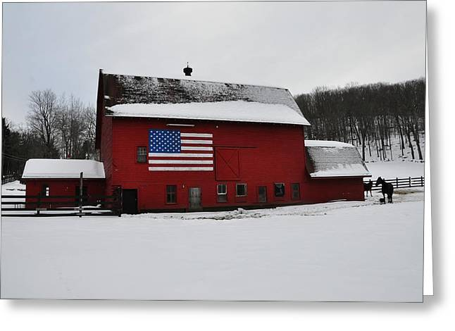 Red Barn With Flag In The Snow Greeting Card by Bill Cannon