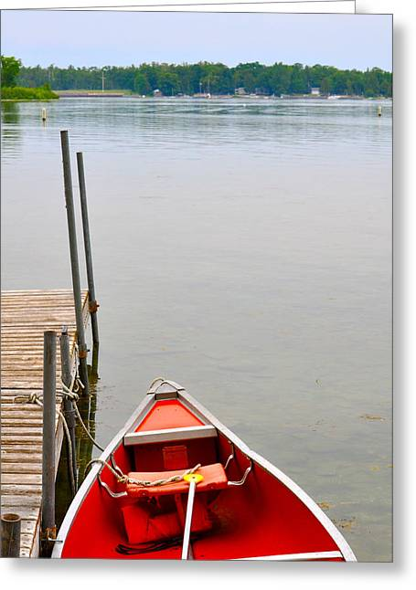 Red Canoe Greeting Card by Jeremy Evensen
