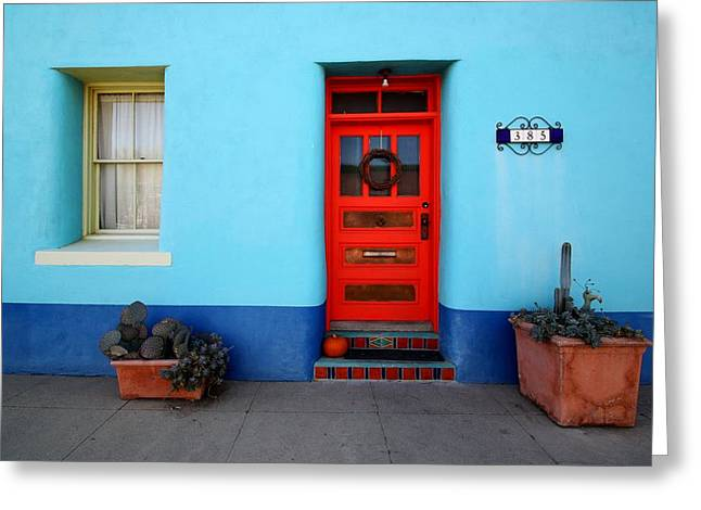 Red Door On Blue Wall Greeting Card