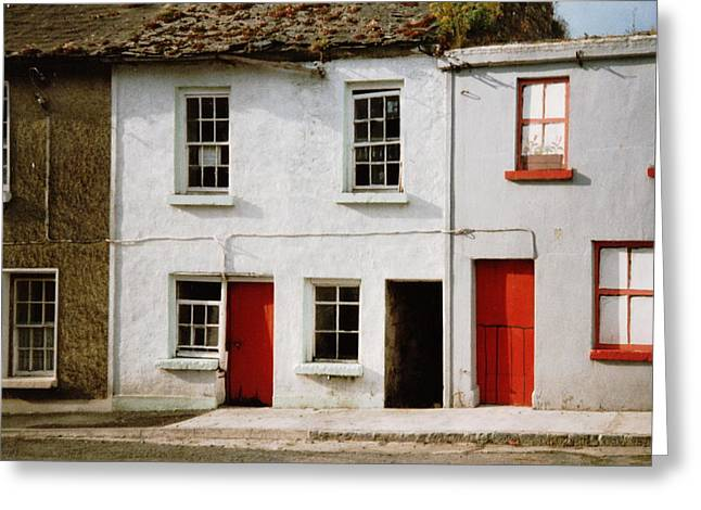 Red Doors Dilapidation Greeting Card by Val Byrne