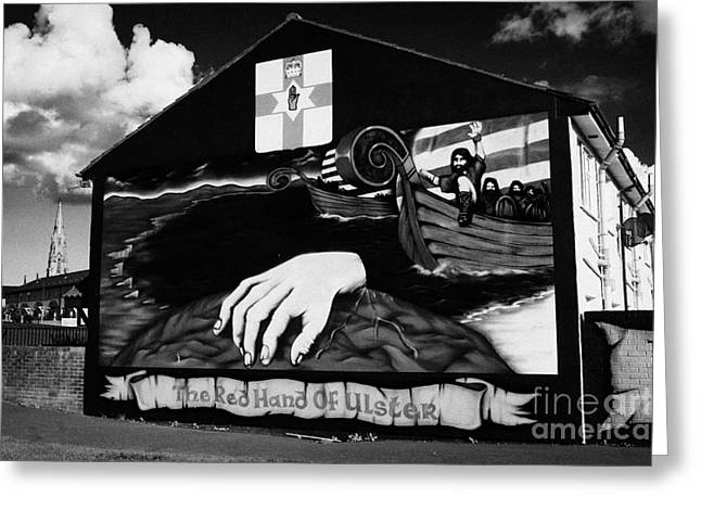 red hand ulster loyalist murals in the Lower Shankill Road area of West Belfast Northern Ireland Greeting Card