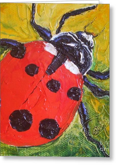Red Ladybug Greeting Card by Paris Wyatt Llanso