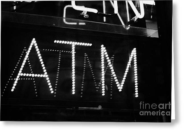 red led atm sign in the window of a store Vancouver BC Canada Greeting Card by Joe Fox