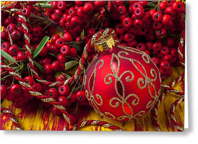 Red Ornament And Berries Greeting Card by Garry Gay