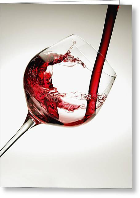 Red Wine Pouring Into A Glass Greeting Card by Richard Desmarais