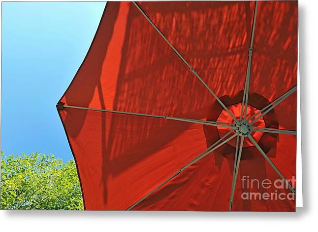 Reddish Umbrella Against Blue Sky Greeting Card by Sami Sarkis