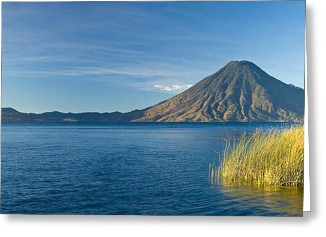 Reeds In A Lake With A Mountain Range Greeting Card by Panoramic Images