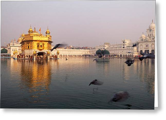 Reflection Of A Temple In A Lake Greeting Card by Panoramic Images