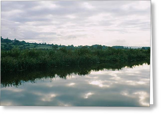 Reflection Of Clouds In The River Greeting Card by Panoramic Images