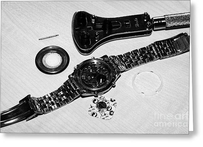 Replacing The Battery In A Metal Band Wristwatch Greeting Card by Joe Fox