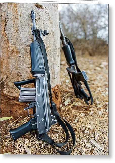 Rhino Security Patrol Guns Greeting Card by Peter Chadwick