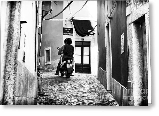 Riding In Alfama Greeting Card by John Rizzuto