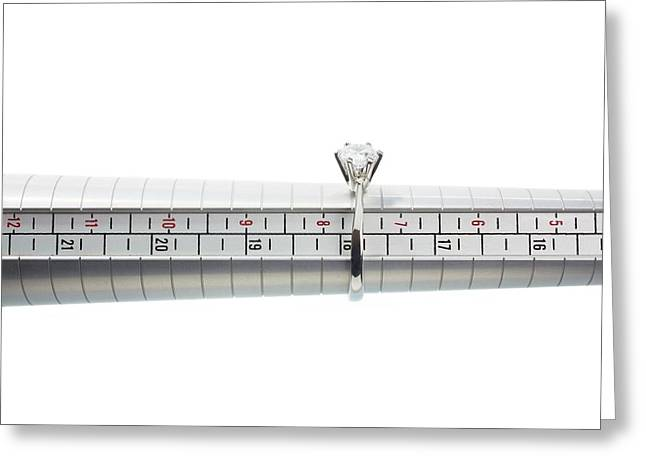 Ring Size Measuring Tool And Ring Greeting Card by Science Photo Library