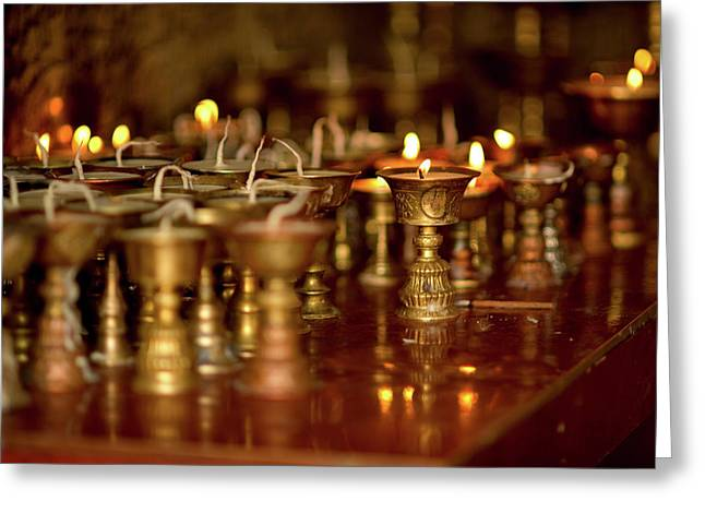 Ritual Lamps In A Buddhist Monastery Greeting Card by Jaina Mishra