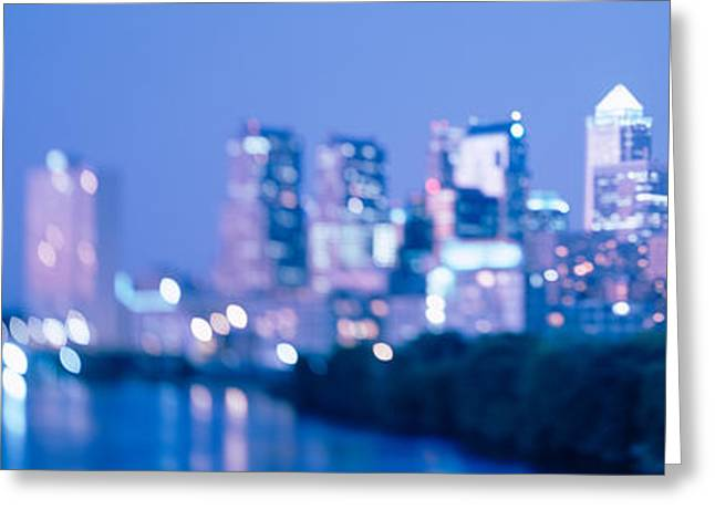 River Passing Through A City Greeting Card by Panoramic Images