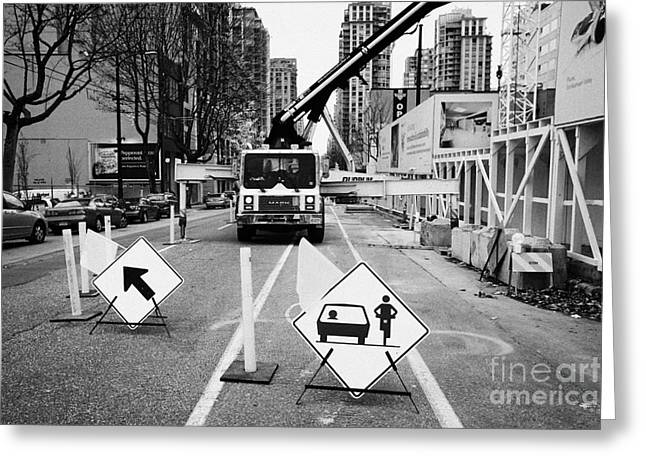 road closed to traffic to allow large articulated crane operate at building site Vancouver BC Canada Greeting Card