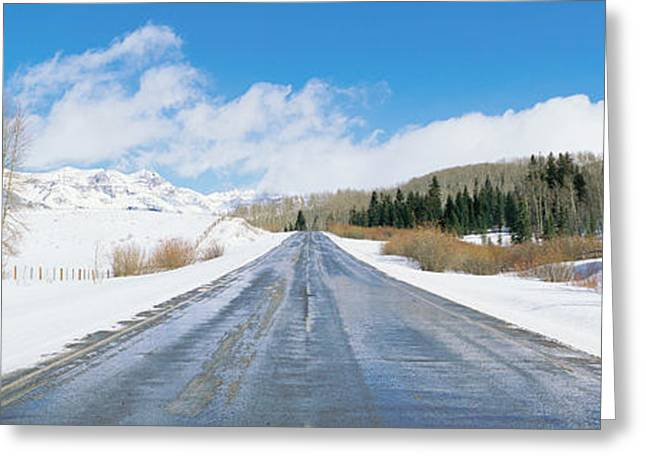 Road Through Snow Covered Countryside Greeting Card