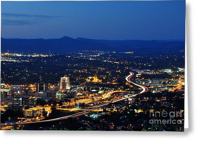 Roanoke City As Seen From Mill Mountain Star At Dusk In Virginia Greeting Card by Paul Fearn