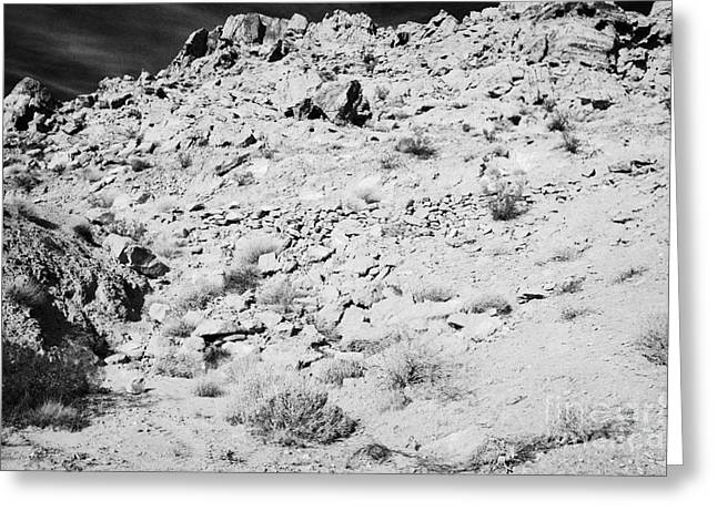Rocks Forming Support For The Old Arrowhead Trail Road Valley Of Fire State Park Nevada Usa Greeting Card by Joe Fox