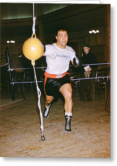 Rocky Marciano Striking Bag Greeting Card by Retro Images Archive