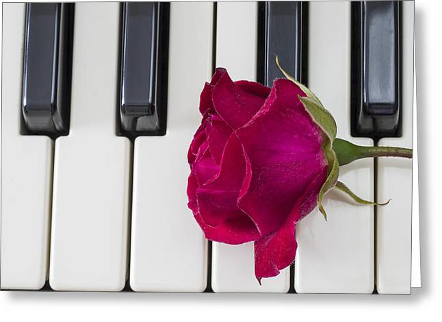Rose Over Piano Keys Greeting Card
