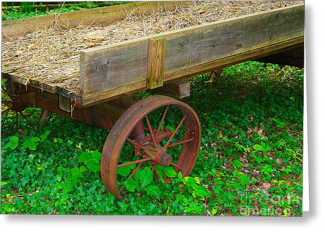 Greeting Card featuring the photograph Rusted Wagon Wheel by Val Miller