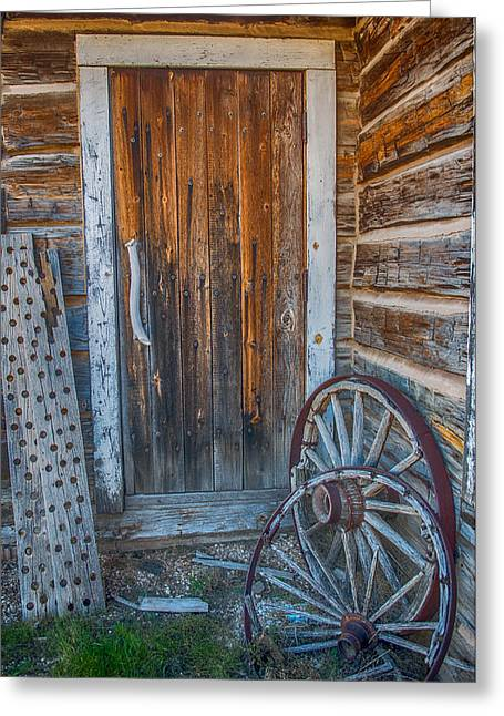 Rustic Door And Wagon Wheels Greeting Card by Paul Freidlund
