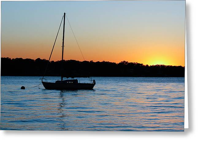 Greeting Card featuring the photograph Sailboat Moored At Sunset by Ann Murphy