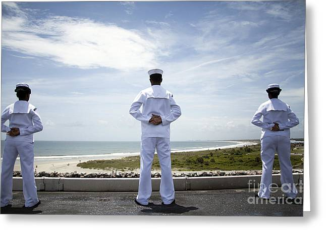 Sailors Man The Rails As The Ship Pulls Greeting Card by Stocktrek Images
