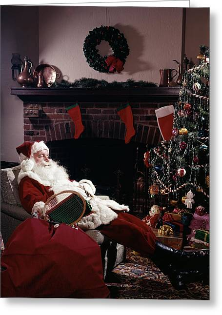 Santa Claus Asleep In Chair In Front Greeting Card