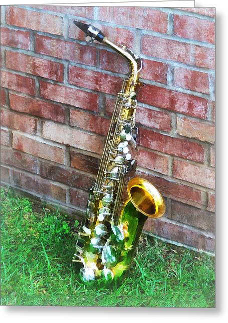 Saxophones Greeting Cards - Saxophone Against Brick Greeting Card by Susan Savad