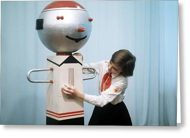 Schoolgirl With Performing Robot Greeting Card by Ria Novosti