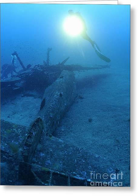 Scuba Divers Exploring Airplane Wreck Greeting Card by Sami Sarkis