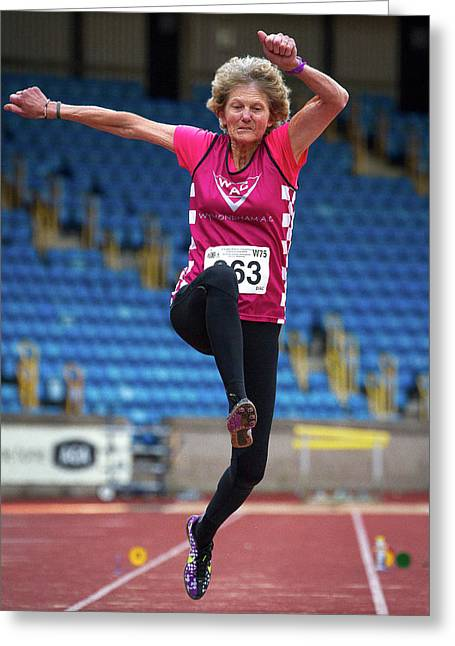 Senior British Female Athlete Mid-air Greeting Card by Alex Rotas