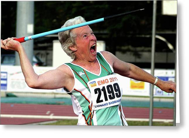 Senior Female Athlete Throws Javelin Greeting Card by Alex Rotas