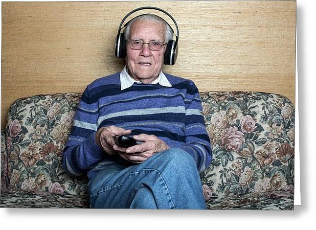 Senior Man Wearing Headphones Greeting Card by Mauro Fermariello