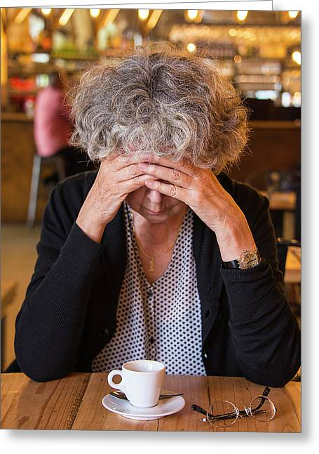 Senior Woman In Cafe With Head In Hands Greeting Card