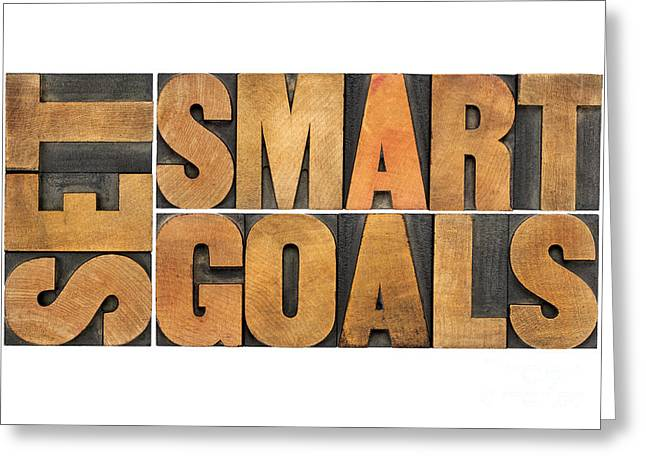 Greeting Card featuring the photograph Set Smart Goals In Wood Type by Marek Uliasz