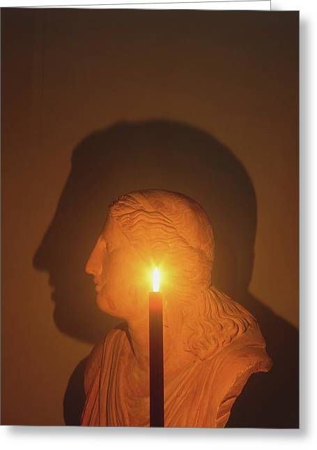Shadow Of A Bust In Candle Light Greeting Card by Dorling Kindersley/uig