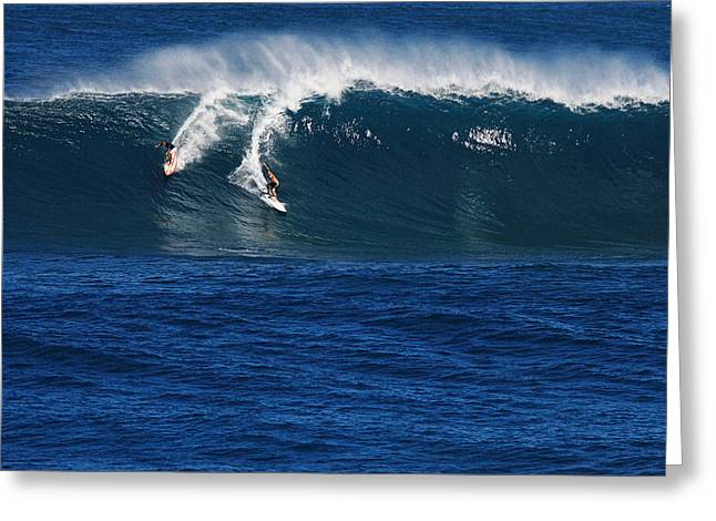 Sharing A Wave In Waimea Bay Greeting Card by Richard Cheski