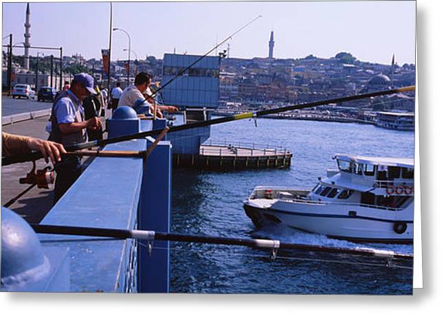 Side Profile Of Fishermen Fishing Greeting Card by Panoramic Images