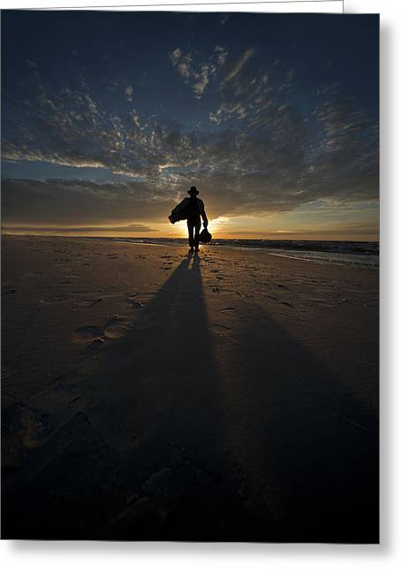 Silhouette Of A Man Wearing Hat And The Bag In Hand Walking On The Seashore Greeting Card by Jaroslaw Blaminsky