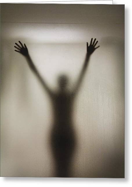 Silhouette Of A Nude Woman Behind The Greeting Card