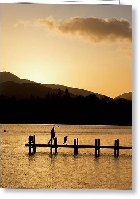 Silhouette Of A Parent And Child Greeting Card by John Short